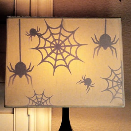Such a quick, easy and fun way to decorate for Halloween. Watch the Spiders magically appear as the sun goes down and the lamps turn on!