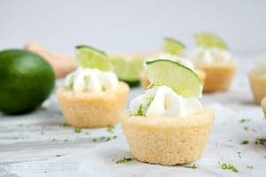 Lime cookie cups. Sugar cookie cups filled with lime cheesecake and topped with whipped cream.