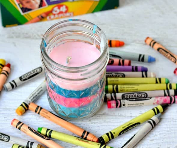 Turn old crayons into a new colorful candle! Perfect craft for kids to help!