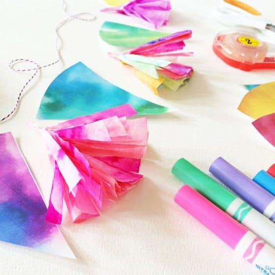 How to make watercolor rainbow tassles! My kids would love this easy craft!