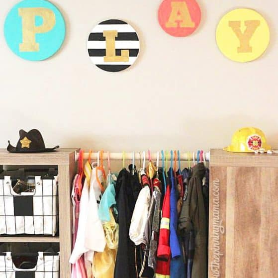 DIY Playroom sign - You will NOT believe what this is made of. Genius!