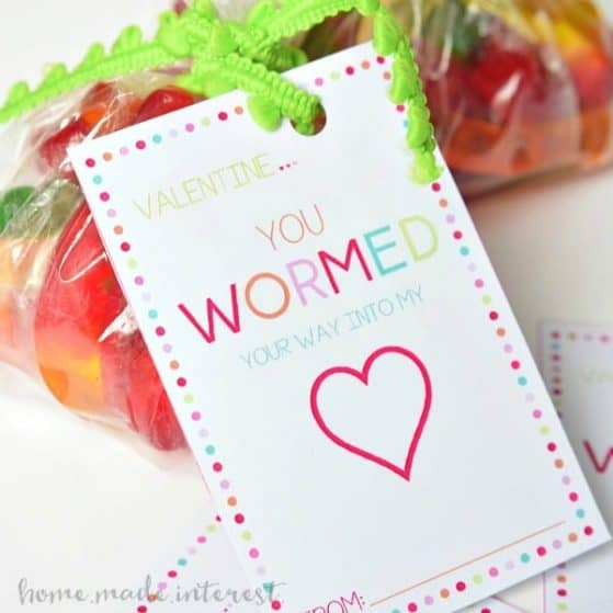 These Valentine's Day Classroom Favors are the cutest! Print out the free printable Valentine's Day card and put a smile on every kid's face with this gummy worm valentine.