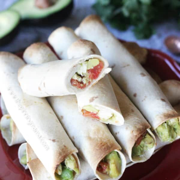 Easy Baked Chicken and Avocado Taquitos - These are the perfect appetizer since you can make a huge batch in the oven pretty quickly. I love any recipe with lots of avocado so these are perfect!