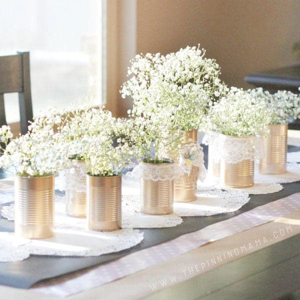 DIY Gold + Lace Shabby Chic Tin Can centerpiece for a tablescape.  If you need vintage decor then this is perfect!  It is super easy craft to make and the finished product is stunning!