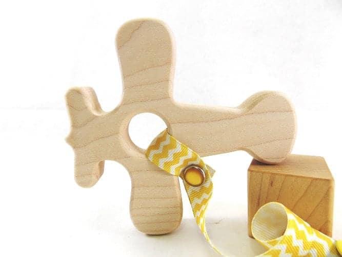 10+ Beautiful Handmade Baby Gifts: Wooden Airplane Teether  www.thepinningmama.com