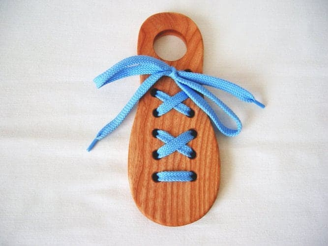 10+ Beautiful Handmade Baby Gifts: Wooden Lacing Toy   www.thepinningmama.com
