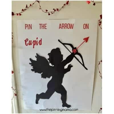 Pin the arrow on CUPID game for school parties.