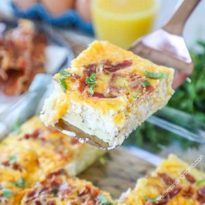 Easy Breakfast Casserole with Bacon being served on a spatula