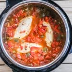 Chicken Fajita Soup Step 3: Place the chicken breasts in the pot and put them down until covered with the liquid.