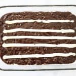 Step 2: Spread lines of cream cheese lengthwise down the brownie pan