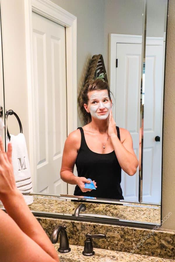 Girl washing face in morning