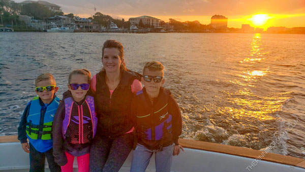 Leaving Destin Harbor on a fishing charter with kids at sunrise