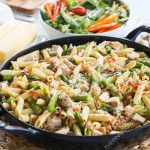 Garlic Butter Pasta in Skillet with bacon and asparagus